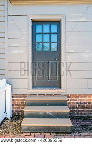 Old wooden front door with steps