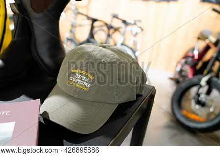 Toulouse , Ocitanie France  - 06 25 2021 : Deus Customs Cap In The Store With Logo Brand Fashion Sho