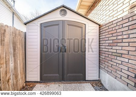 Vinyl Outdoor Shed With With Walls And Gray Double Door