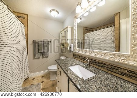 Traditional Bathroom Interior With Limestone Tiles And Vanity Unit With Granite Counter