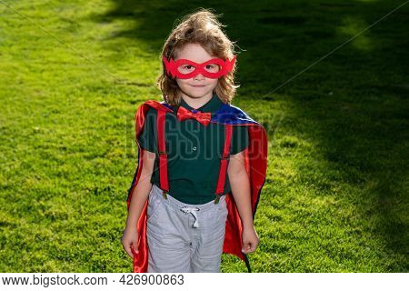 Child Superhero With Red Cloak In Glasses. Success, Motivation Concept. Boy Superhero.