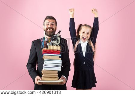 Father Or Teacher Hold Big Stack School Textbook Notebook Books. Happy Excited Preteen Girl Wears Sc