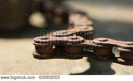 Rusty Bicycle Chain. Old Bicycle Chain With Rust. Bicycle Parts Unusable. Close-up. Chain Macro Phot