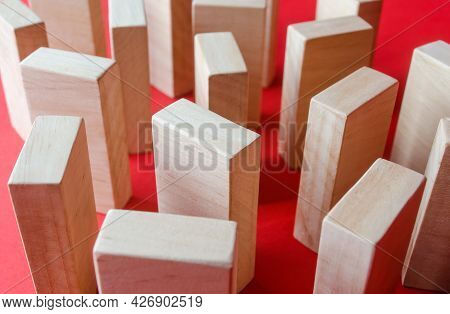Wooden Blocks On A Red Background. Concept Of A Maze Labyrinth Of Wardrobes Or Dense Urban Construct
