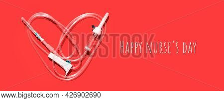 Medical Dropper In The Shape Of A Heart On A Pink Background. Greeting Card For The Day Of The Medic