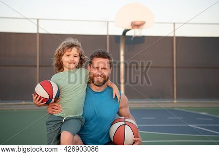 Father And Son Playing Basketball. Family Leisure Activities Concept. Dad And Child Boy Spending Tim