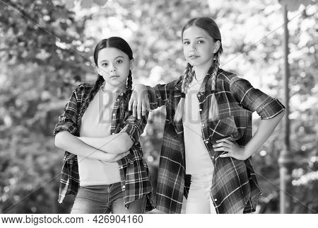 Nice Pupils. Casual Hipsters Outfit. Portrait Of Happy Sisters. Little Kids Girls In Shirt. Two Youn