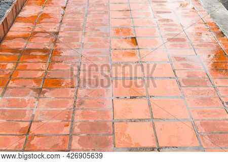Brick Footpath After The Rain. Pavement Of Wet Red Tiles For Background
