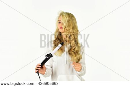 Form Exquisite Curls And Romantic Light Waves. Heat Setting For Hair Type. Woman With Long Curly Hai