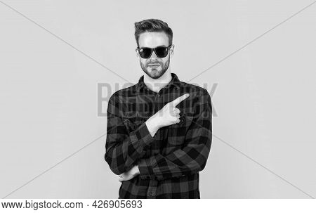 Pointing Finger. Barbershop Concept. Mens Wear. Young Handsome Guy In Checkered Shirt And Glasses. S