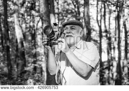 Professional Photographer. Landscape And Nature Photo. Old Photographer Filming. Pension Hobby. Expe