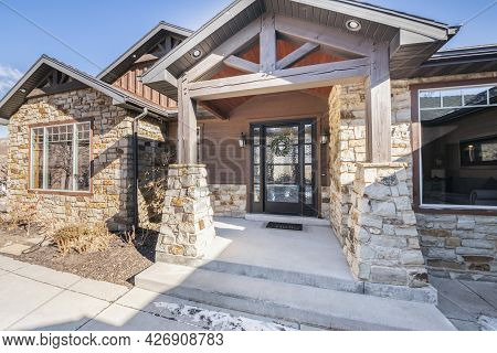 Facade Of A Rustic Bungalow House With Stone Walls
