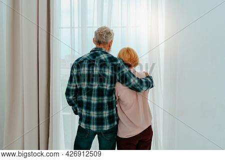 Retired Husband And Wife Hug Each Other At Home