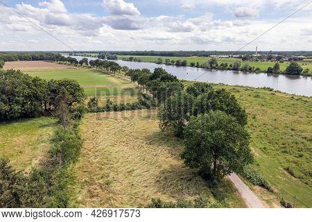 Aerial View Of Dutch River Meuse Near Wellerlooi, Small Village In Province Limburg
