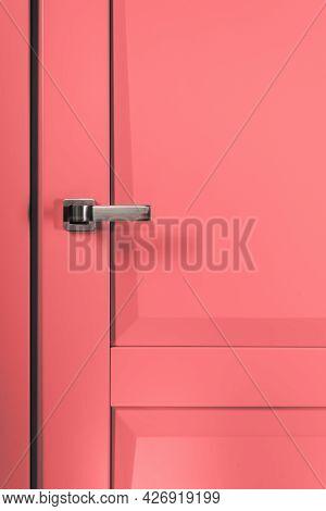 Stainless Stylish Door Knob On Pink Wooden Door