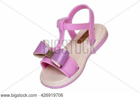 Pink Sandal Isolated. Close-up Of A Cute Single Pink Sandal With A Bow For The Little Girl Isolated