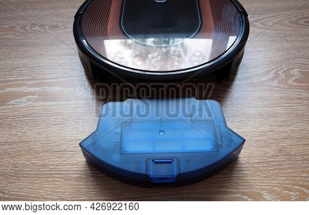 A Robot Vacuum Cleaner For Cleaning The House. Details And A Close-up Of A Modern Robot Vacuum Clean