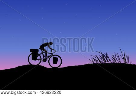 Dark Silhouette Of Touring Bike Cyclist Travel On Mountain With Sunset Background. Biker Cycling Adv