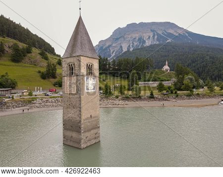 Bell Tower Submerged In The Waters Of The Dam At Resia In Italy