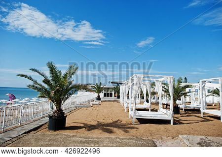 White Canopy And Curtains At Sunny Beach On Black Sea In Bulgaria. Summer Vacation Travel Holiday.