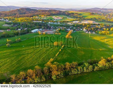 Green Rural Landscape Of Northern Bohemia At Susnet Time. Aerial View From Drone.