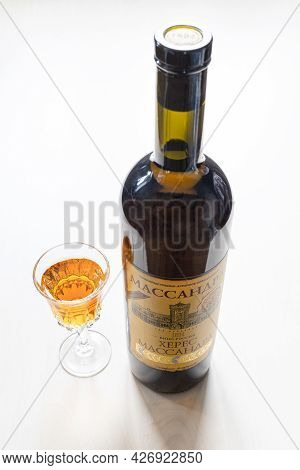 Moscow, Russia - June 10, 2021: Wine Glass And Bottle With Aged Fortified Wine Massandra Sherry From