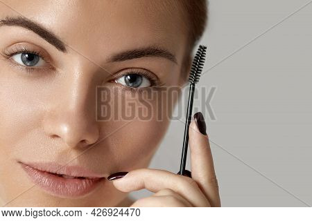 Eyebrow Makeup. Beautiful Woman Shaping Brows With Brush   Closeup. Beauty Girl Model With Professio