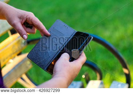 Defocus Close-up Female Hands Touching On The Phone Outside, Outdoor. Woman In Purple Blouse Using S