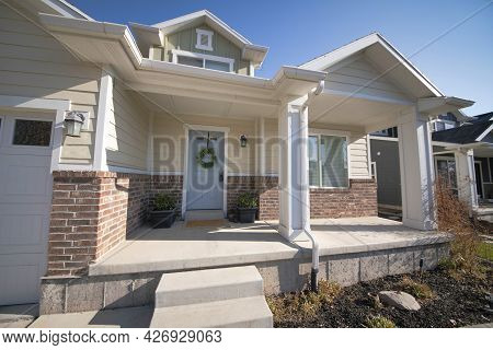 Front Porch Of A Bungalow Home With Concrete Stairs