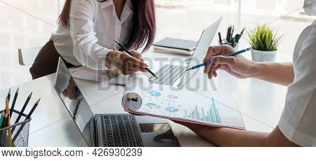Diverse Businesspeople Discuss Financial Report In Charts Diagrams And Graphs Close Up Above View, B