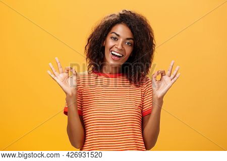 Waist-up Shot Of Chill Outgoing Calm Girlfriend With Confident Look In Trendy Striped T-shirt Showin