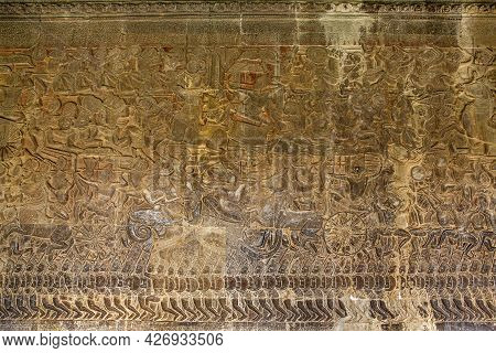 The Low Relief Carvings Surrounding Angkor Wat Belong To The Khmer Empire. Located In The Center Of