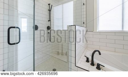 Pano Shower Stall With Tiles And Cohesive Plumbing Fixtures