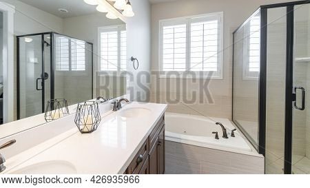 Pano Interior Of A Master Bathroom With Double Vanity Sink And Windows