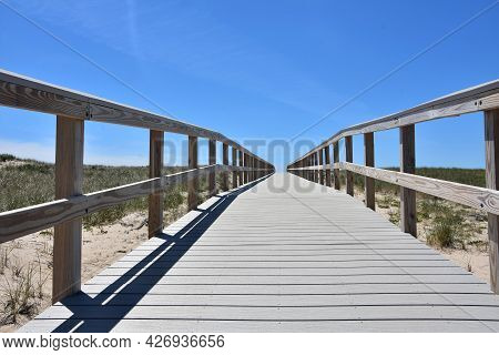 Wood Boardwalk Over Sand Dunes On The Cape.