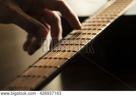 Play The Guitar By Hands. Artist. Musician. Hands Playing Acoustic Guitar, Close Up.