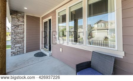 Pano Front Exterior Of A House With Windows, Door And Stone Brick Wall