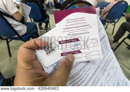 Kuala Lumpur, Malaysia, July 16, 2021: Patient Holding Card With First Astrazeneca Dose Vaccination