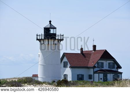 Lighthouse Tower And Keepers Home On Cape Cod.