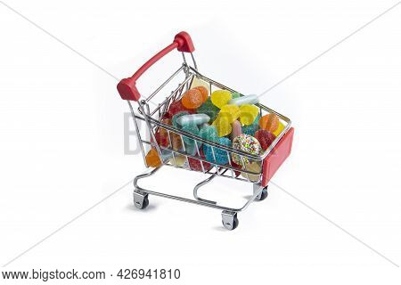 Shopping Red Cart Full Of Colorful Tasty Jelly Candies Isolated On White Background
