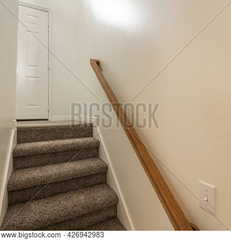 Square Frame Interior Of A Basement Stairs In A House With Window And Lights