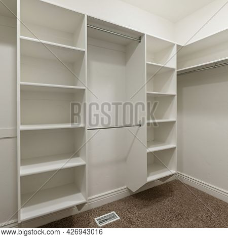 Square Frame Interior Of An Empty Walk-in Closet Room With Floor Vent