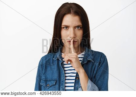 Close Up Of Serious And Angry Woman Hushing, Press Finger To Lips In Shush Quiet Gesture, Frowning D