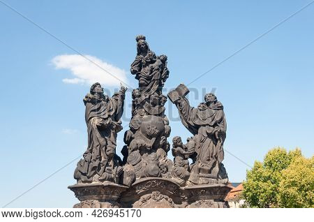Statue Of Madonna With Saint Dominic And Saint Thomas Aquinas On Charles Bridge In Prague, Czech Rep