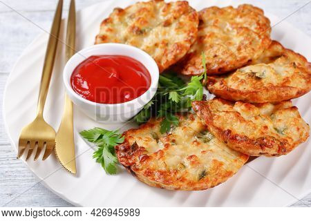 Cheesy Chicken Fritters, Chicken Breast Patties Served With Tomato Sauce On A White Plate With Golde