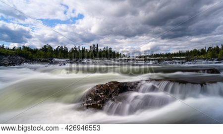 View Of The Trappstegsforsarna Waterfall In Northern Sweden