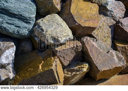 Background Is Made Of Natural Stones Of Different Colors And Sizes. Natural Texture. Brown Granite.t