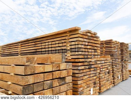 Stack Of Lumber And Planks In A Lumber Warehouse Outdoors