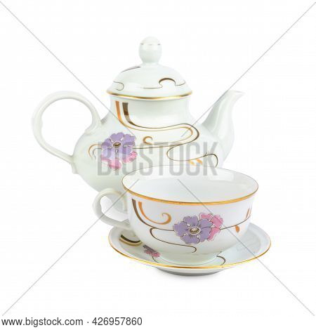 Vintage Porcelain Teapot And Tea Cup With Saucer Isolated On White Background.