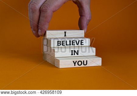 I Believe In You Symbol. Concept Words 'i Believe In You' On Wooden Blocks On A Beautiful Orange Bac